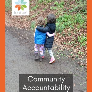 """Two four-year old female-presenting humans walking down a street, arm in arm, with their backs to the camera. Over the image are the words """"Community Accountability"""" and the Keduzi logo, which is a colourful flower."""