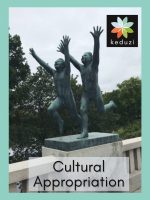 """Statues by Gustav Vigeland in Oslo, Norway, of two young humans running scared. Over the image are the words, """"Cultural Appropriation"""" and the Keduzi logo, which is a colourful flower."""